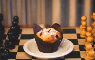 Muffin in the middle of a chess game.