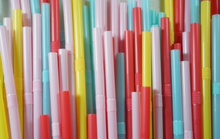 pink, yellow, blue, red bendy straws in a pile